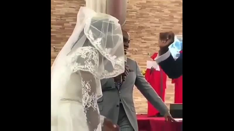 Groom's reaction as he unveils his bride