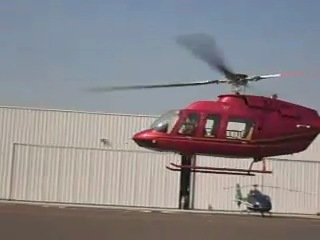 Вертолёт Белл 407.
