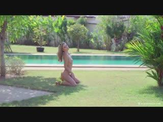 Naked girl near the pool