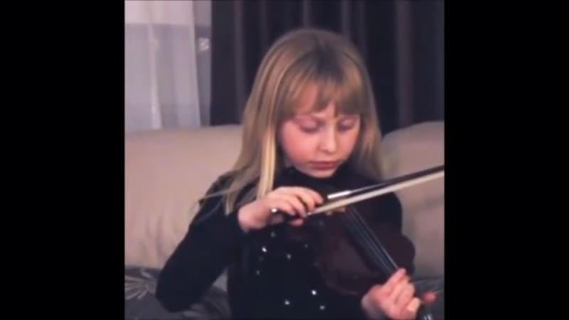 Girl is playing violin vine