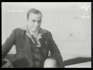 Bert Hinkler arrives at Hanworth after record breaking New York - London flight (1931)